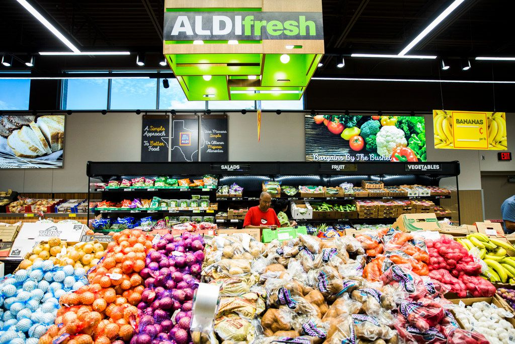 Shoppers browse the produce section of a newly renovated Aldi grocery store on Gaston Avenue on Sept. 20, 2018 in Dallas.