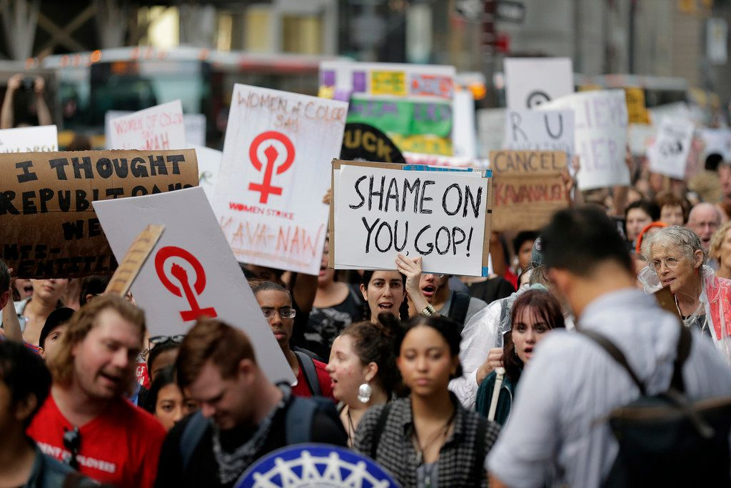 Protesters march to Times Square in New York, Thursday, Oct. 4, 2018. Hundreds of people rallied in front of Trump Tower then walked to Times Square to protest Supreme Court nomineeBrett Kavanaugh. (AP Photo/Seth Wenig)