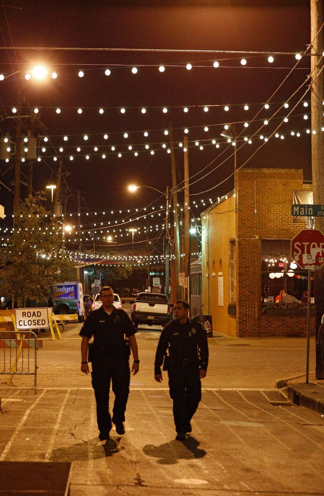 Off-duty police patrolled Deep Ellum last fall as part of private patrols paid for by businesses.
