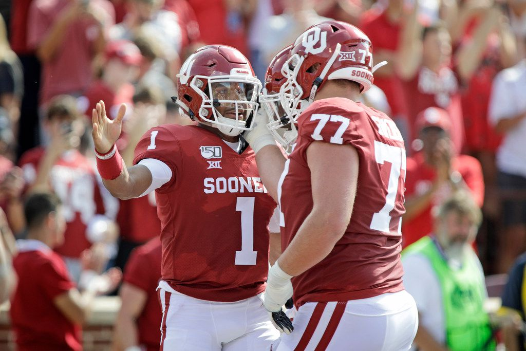 NORMAN, OK - SEPTEMBER 28:  Quarterback Jalen Hurts #2 celebrates his touchdown with left tackle Erik Swenson #77 of the Oklahoma Sooners against the Texas Tech Red Raiders at Gaylord Family Oklahoma Memorial Stadium on September 28, 2019 in Norman, Oklahoma. (Photo by Brett Deering/Getty Images)