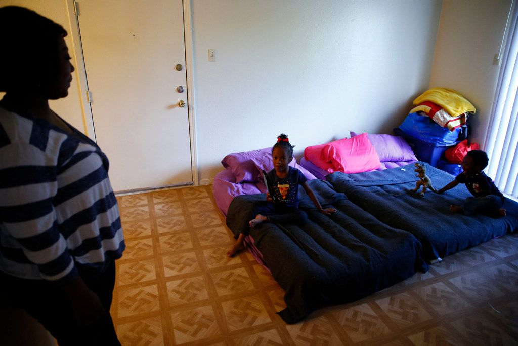 Sherrie Miles watches her two kids Nylah Miles (center), 5, and Zatakyyus Miles, 3, play in their new apartment in Dallas after they decided to leave Port Arthur because of Hurricane Harvey.