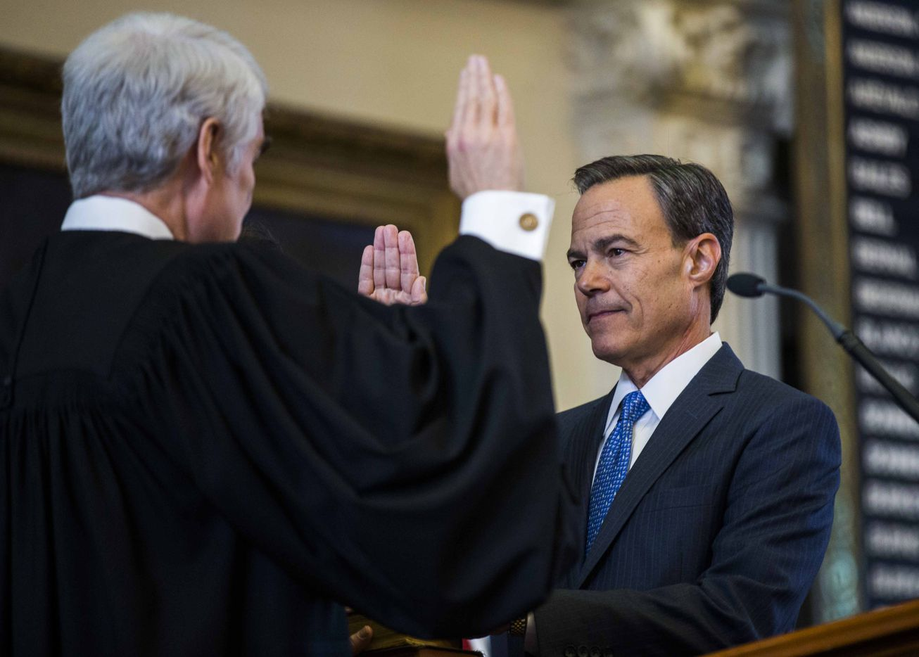 Texas State Rep. Joe Straus (right) is sworn in as Speaker of the House by Texas Chief Justice Nathan Hecht during the first day of the 85th Texas Legislative Session on Tuesday at the Texas State Capitol in Austin.