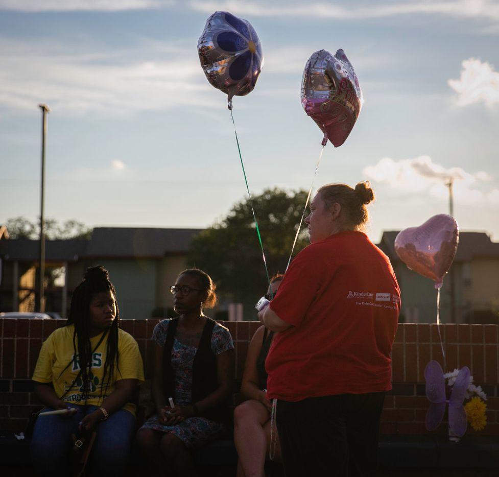 Amy Johnson hold balloons for a prayer vigil held in honor of Kaytlynn Cargill at Central Junior High School in Euless, Texas on June 22, 2017.