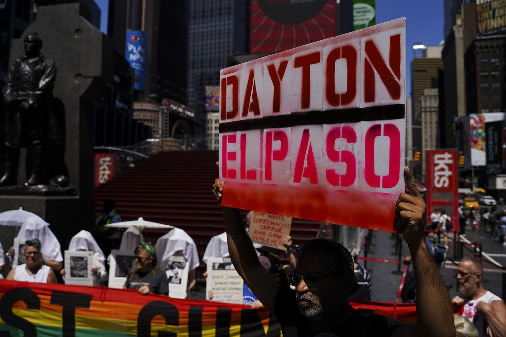 NEW YORK, NY - AUGUST 04: Protesters hold a rally against gun violence in Times Square in response to recent mass shootings in El Paso, Texas and Denton, Ohio on August 4, 2019 in New York City. (Photo by Go Nakamura/Getty Images)