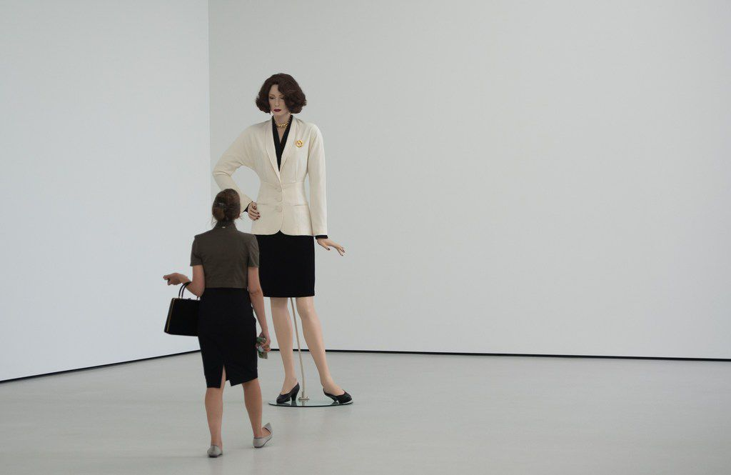 """A woman looks at artist Charles Ray's """"Fall '91"""" artwork as she tours the Pavilions, a new building at the Glenstone museum, combining art, architecture and landscape."""
