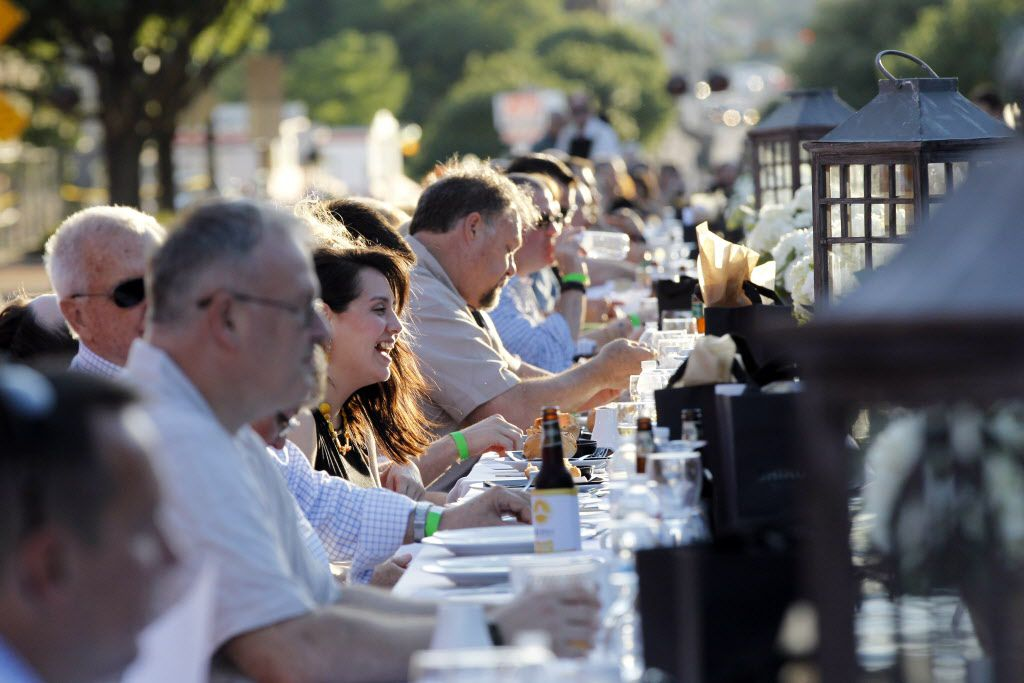 """People enjoy sunny weather during the first """"Night Out on 15th"""" on 15th Street in the historic downtown Plano, TX on Sunday, May 31, 2015."""