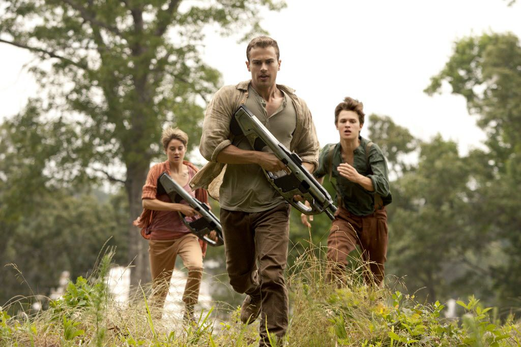 """In this image released by Lionsgate, Theo James, center, Shailene Woodley and Ansel Elgort appear in a scene from """"The Divergent Series: Insurgent."""""""