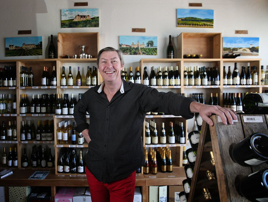 Owner Thierry Plumettaz poses for a photograph at Le Caveau Vinotheque wine shop in Dallas.