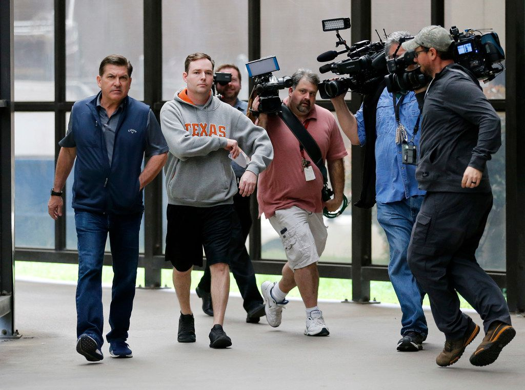News photographers chase Austin Shuffield, 30, (second from left) as he leaves the Frank Crowley Courthouse after being released on a $1000 bond, Friday, March 29, 2019.  Shuffield was booked into the Dallas County Jail about 8:15 a.m. Friday on an unlicensed-weapon charge, one of four misdemeanors he faces, along with assault, interfering with an emergency call and public intoxication. The latest arrest warrant for Shuffield reveals that police believe he pulled out a gun during his argument with L'Daijohnique Lee, just before the March 21 fight.