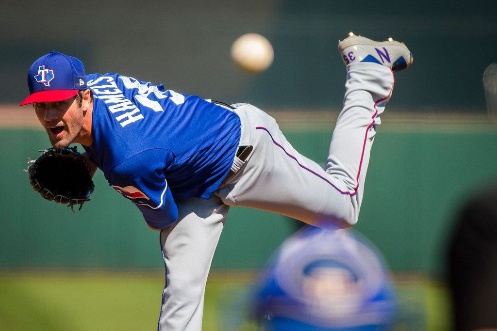 Texas Rangers pitcher Cole Hamels pitches during the second inning of a spring training baseball game against the San Francisco Giants on Saturday, March 3, 2018, in Scottsdale, Ariz. (Smiley N. Pool/The Dallas Morning News)