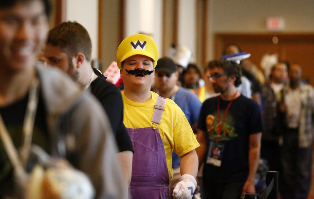 Dustin Dodd as Wario from Mario Brothers waits in line to enter the dealers rooms at AnimeFest 2015 in downtown Dallas Saturday September 5, 2015.