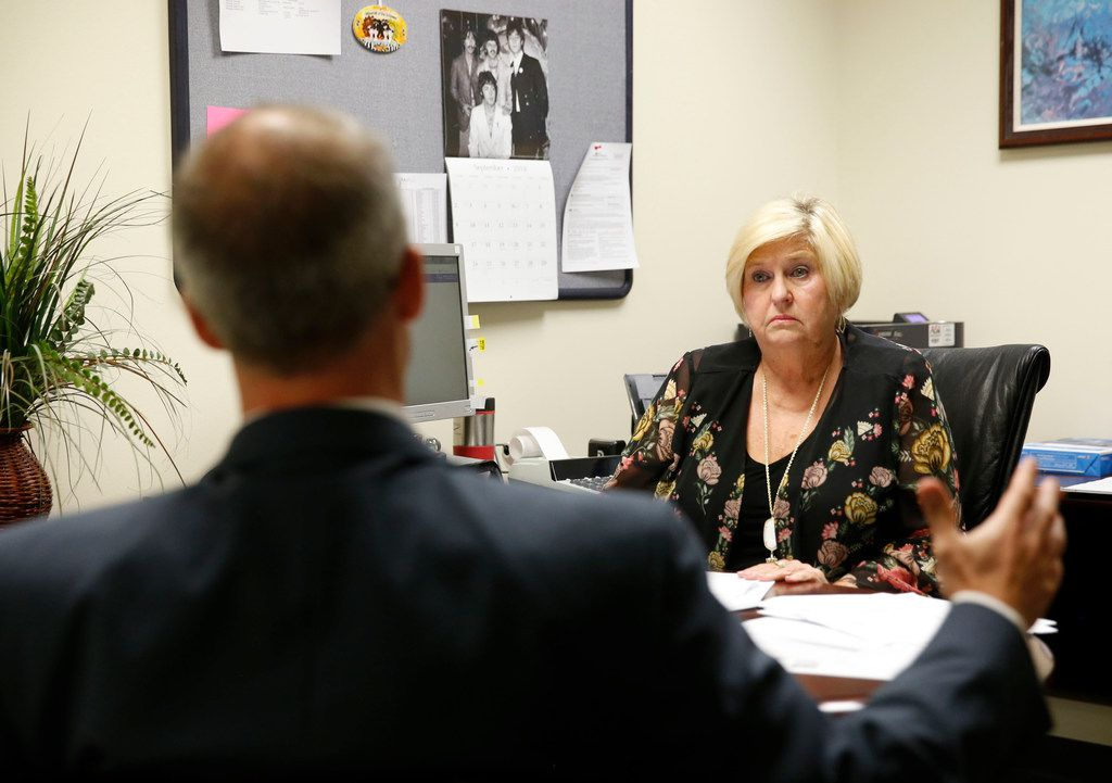 Attorney Dan Tobin talks with accounting manager Pam Eaton in her office at SettlePou in Dallas in September.