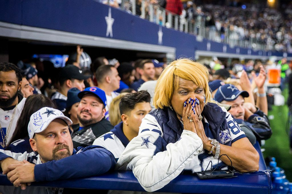Dallas Cowboys fan Carolyn Price reacts after the  Green Bay Packers kicked a 51-yard game-winning field goal on the final play of an NFC divisional round playoff game at AT&T Stadium on Sunday, Jan. 15, 2017, in Arlington. (Smiley N. Pool/The Dallas Morning News)