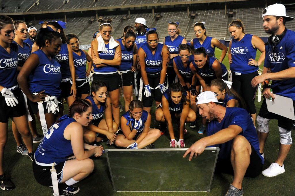 Brunettes huddle for a play by play at Blondes vs. Brunettes powder puff game at Cotton Bowl in Dallas on Aug. 13, 2016.