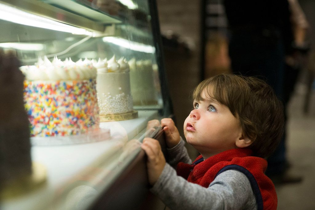 Jackson Miles of Fort Worth, 1, eyes pastries at Gigi's Cupcakes at the Food Hall at Crockett Row in Fort Worth.
