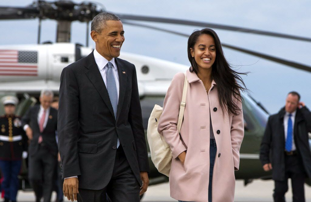 President Barack Obama, with daughter Malia, has seen hate-filled words and personal attacks hurled at his family.