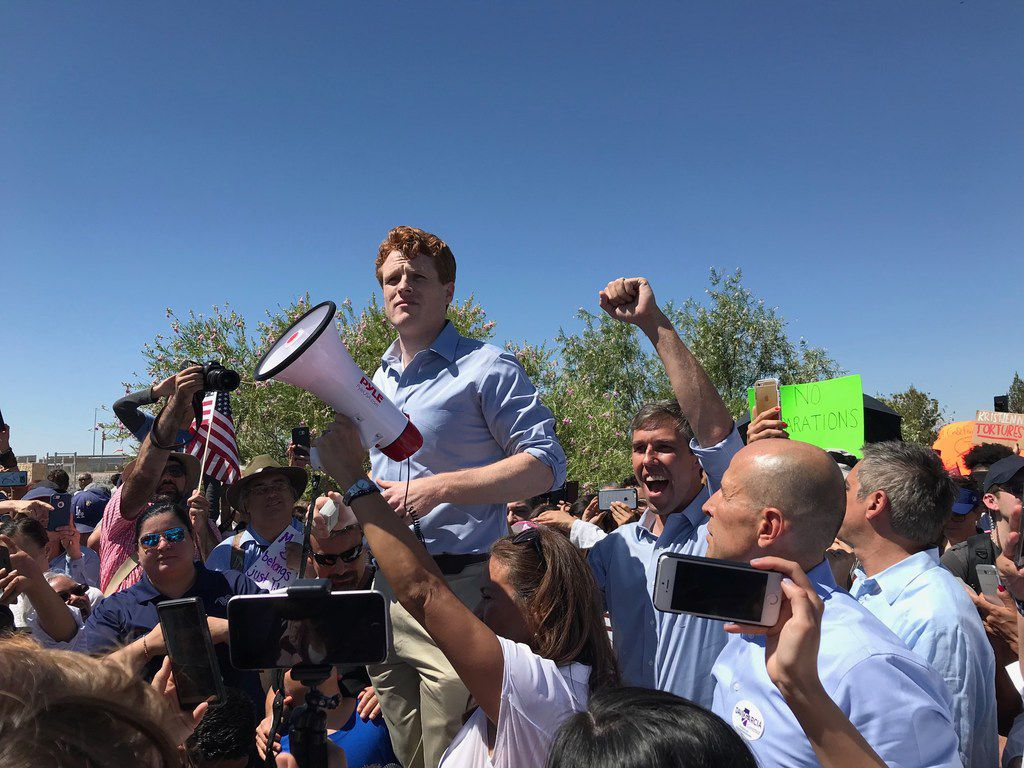 U.S. Rep. Joe Kennedy III, D-Mass., joined protesters near Tornillo, Texas, to protest Trump's immigration policies. Next to him is U.S. Rep. Beto O'Rourke, raising his arm. Outraged over the Trump administration's policy of  splitting up families entering the country illegally, protesters marched Sunday, June 17, 2018 to a shelter where children are being held outside this tiny farming community south of El Paso.