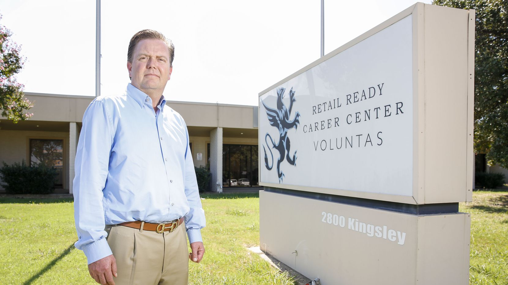 CEO and Founder Jon Davis of the Retail Ready Career Center stands outside the building that still houses his business in Garland, Texas Thursday September 26, 2019. He is accused of scamming the governments GI Bill out of millions, but has not been accused of a crime. Two years ago, the feds raided his business, froze his bank accounts and shut him down.