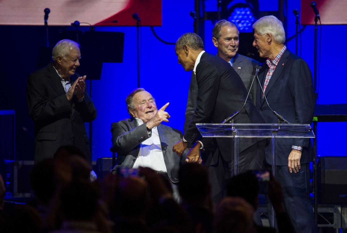 Former presidents Jimmy Carter, George H. W. Bush, Barack Obama, George W. Bush, and Bill Clinton speak during Deep from the Heart: The One America Appeal Concert.