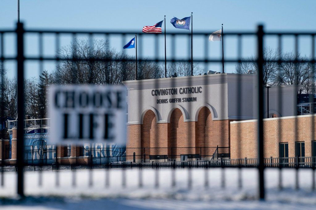 Flags fly over the Covington Catholic High School stadium in Park Kills, Ky., on Sunday, Jan 20, 2019. A diocese in Kentucky has apologized after videos emerged showing students from the Catholic boys' high school mocking Native Americans outside the Lincoln Memorial on Friday after a rally in Washington.