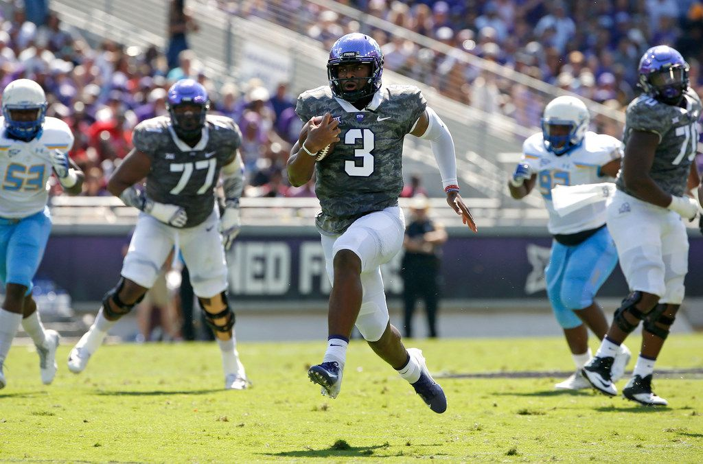 TCU quarterback Shawn Robinson (3) takes off on a 36-yard touchdown run against Southern University during the first half of an NCAA college football game, Saturday, Sept. 1, 2018, in Fort Worth, Texas. (AP Photo/Ron Jenkins)