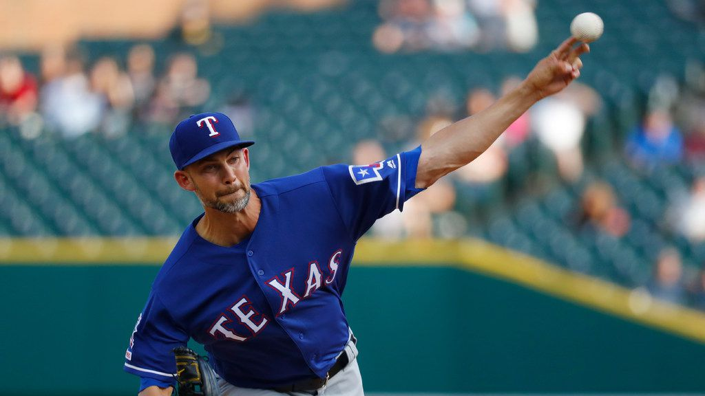 Texas Rangers pitcher Mike Minor throws against the Detroit Tigers in the first inning of a baseball game in Detroit, Wednesday, June 26, 2019. (AP Photo/Paul Sancya)