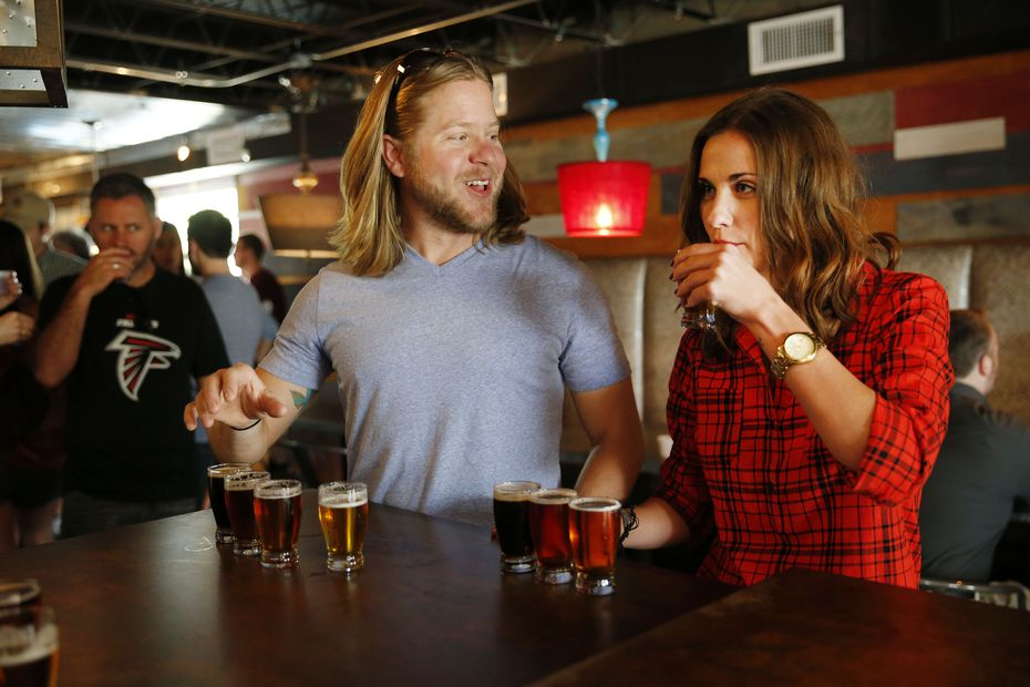 Ryan Bloom (left) and Ashley Taylor (right), both of Austin, Texas, try sample beers after a brewery tour of Four Corners Brewing Co. in Dallas.