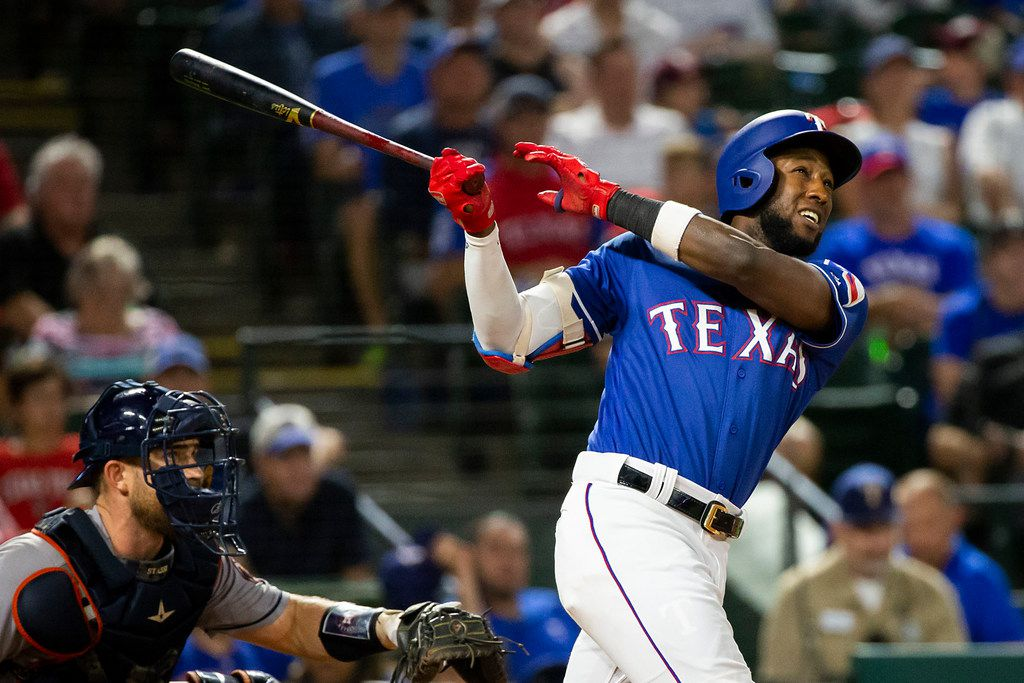 FILE - Texas Rangers shortstop Jurickson Profar flies out with runners on during the seventh inning against the Houston Astros at Globe Life Park on Thursday, June 7, 2018, in Arlington. (Smiley N. Pool/The Dallas Morning News)