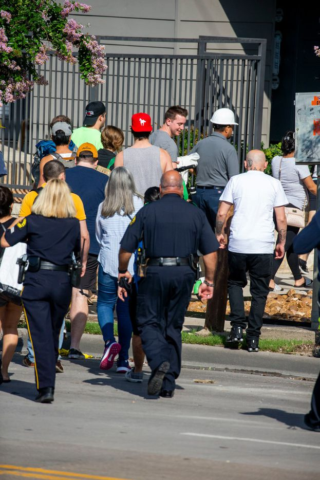 Residents make their way  into Elan City Lights apartments in Dallas on Monday, June 10, 2019. On Sunday, a crane collapsed into the apartments killing one and leaving five others injured. (Shaban Athuman/Staff Photographer)