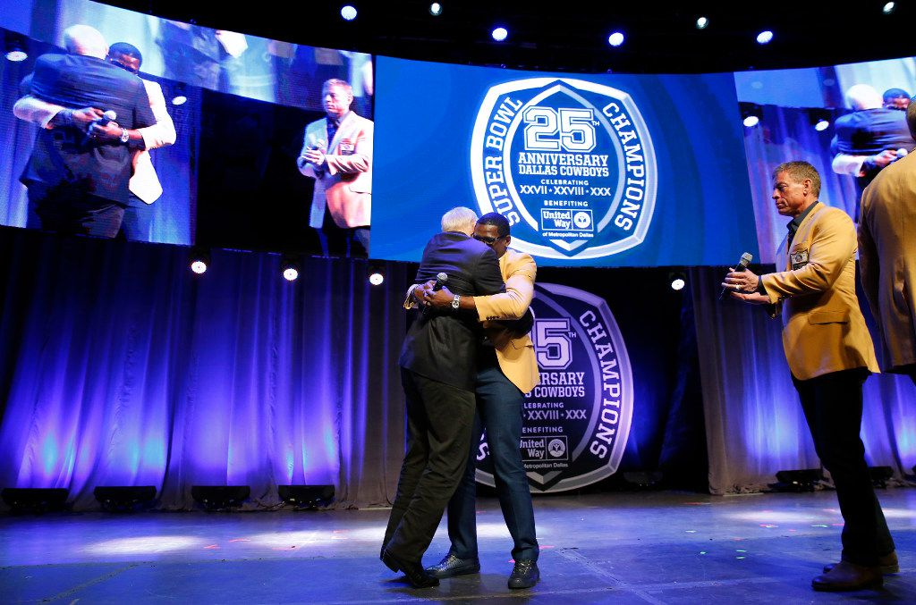 Dallas Cowboys owner Jerry Jones receives a big hug from Michael Irvin after being introduced as the newest Cowboy going to the NFL Hall of Fame. (Tom Fox/The Dallas Morning News)