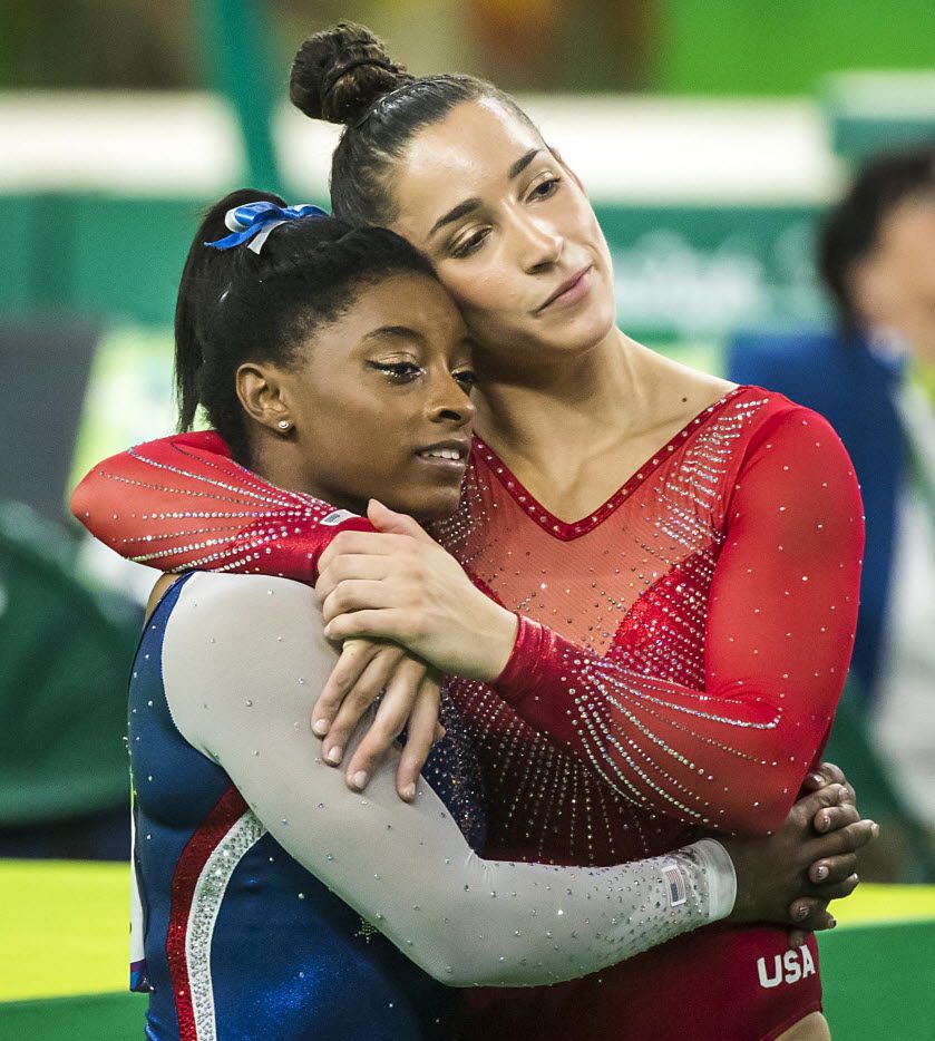 Simone Biles of the United States hugsteammate Aly Raisman as they await their final scores after the floor exercise competition during the women's gymnastics all-around final at the Rio 2016 Olympic Games in Rio de Janeiro.  Biles won the gold.  Raisman took silver.