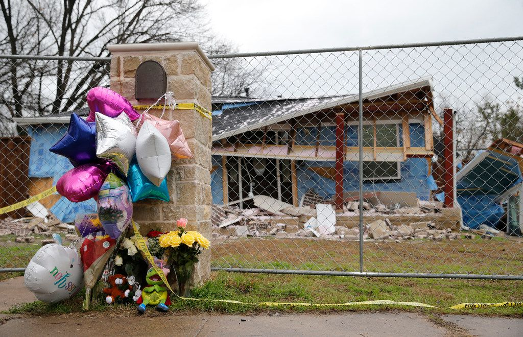 Flowers and balloons were left in front of the house along Espanola Drive in northwest Dallas where Linda Rogers, 12, was killed in February 2018 in a natural-gas explosion.