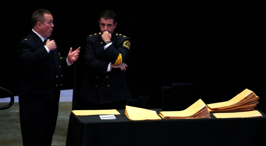 """Deputy Chief Scott Walton (left) talks with Interim Chief of Police David Pughes during the """"Night of Honor"""" awards ceremony at American Airlines Center in Dallas on Thursday, July 6, 2017."""