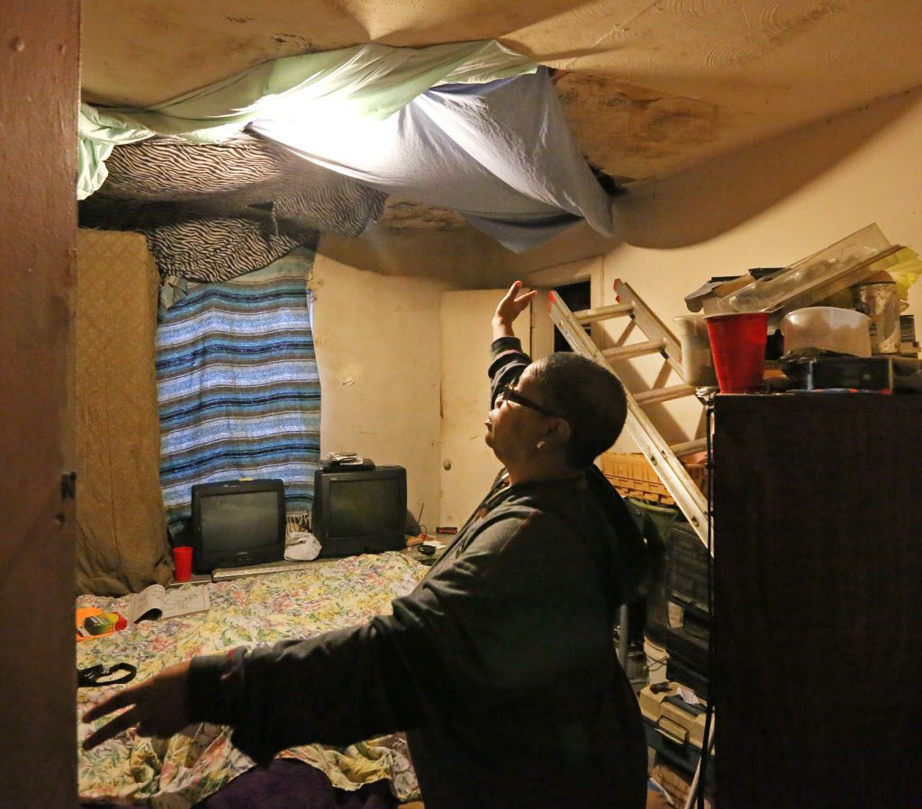 Joanne Bonner lives with a water-damaged ceiling in the home that she and her family rent from Topletz Investments on Lawrence Street in Dallas. (Louis DeLuca/Staff Photographer)