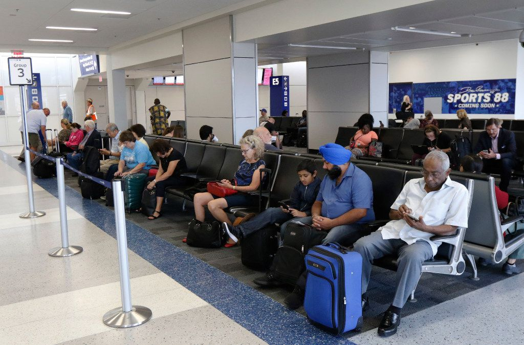 Travelers wait in the newly remolded Terminal E at Fort Worth International Airport on Wednesday, August 23, 2017. Today marks the second completed terminal in DFW's $2.7 billion Terminal Renewal and Improvement Program to renovate three of it's original terminal buildings. (David Woo/The Dallas Morning News)