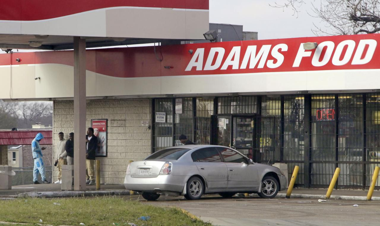 Gangs loiter at Adams Food Mart at Bruton and St. Augustine, buying something only when police pull up, the owner says.