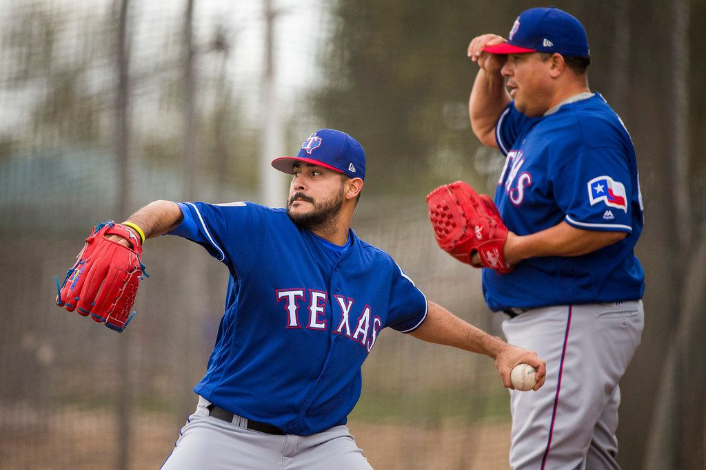 Texas Rangers pitchers Martin Perez (left) and Bartolo Colon work in the bullpen during a spring training workout at the team's training facility on Monday, Feb. 19, 2018, in Surprise, Ariz. (Smiley N. Pool/The Dallas Morning News)