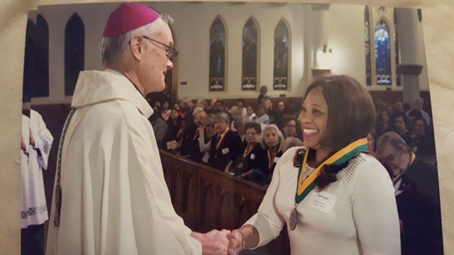 Auxiliary Bishop Gregory Kelly congratulated Myrna Dartson in 2017 after the Dallas diocese presented her the Bishop's Award for Service at the Cathedral Shrine of the Virgin of Guadalupe in downtown Dallas. (Family photo)