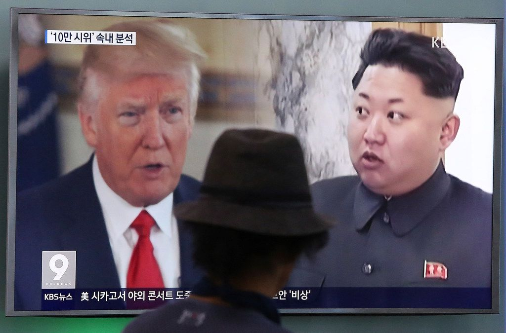 """In this Aug. 10, 2017, file photo, a man watches a television screen showing U.S. President Donald Trump and North Korean leader Kim Jong Un during a news program at the Seoul Train Station in Seoul, South Korea.  South Korea's national security director says President Donald Trump has decided he will meet with North Korea's Kim Jong Un """"by May."""""""