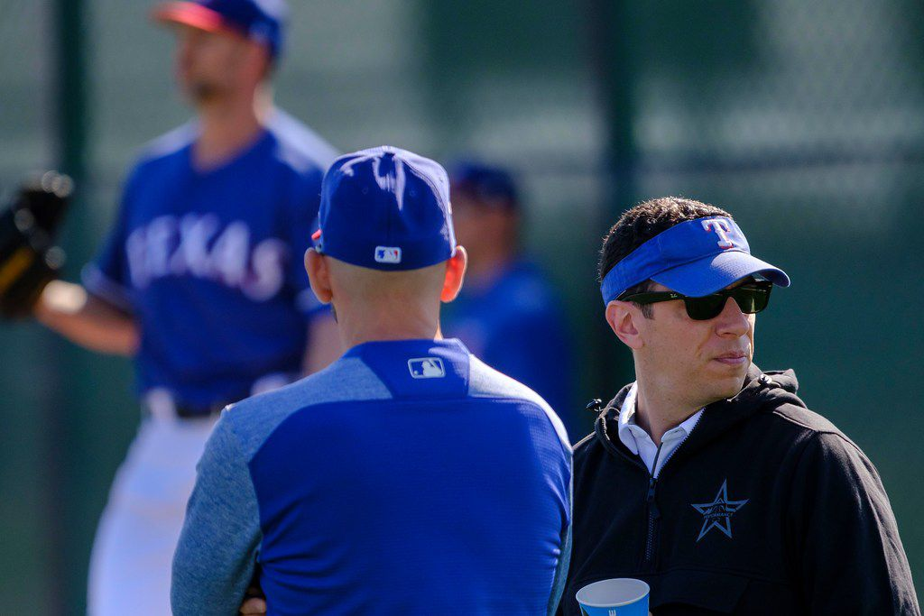 Texas Rangers general manager Jon Daniels (right) watches a bullpen session with manager Chris Woodward during a spring training workout at the team's training facility on Sunday, Feb. 17, 2019, in Surprise, Ariz.. (Smiley N. Pool/The Dallas Morning News)