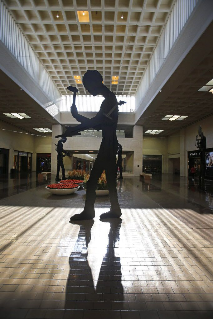 """The sculpture """"Five Hammering Men"""" (1982) by Jonathan Borofsky is pictured at NorthPark Center in Dallas on Thursday, August 13, 2015."""