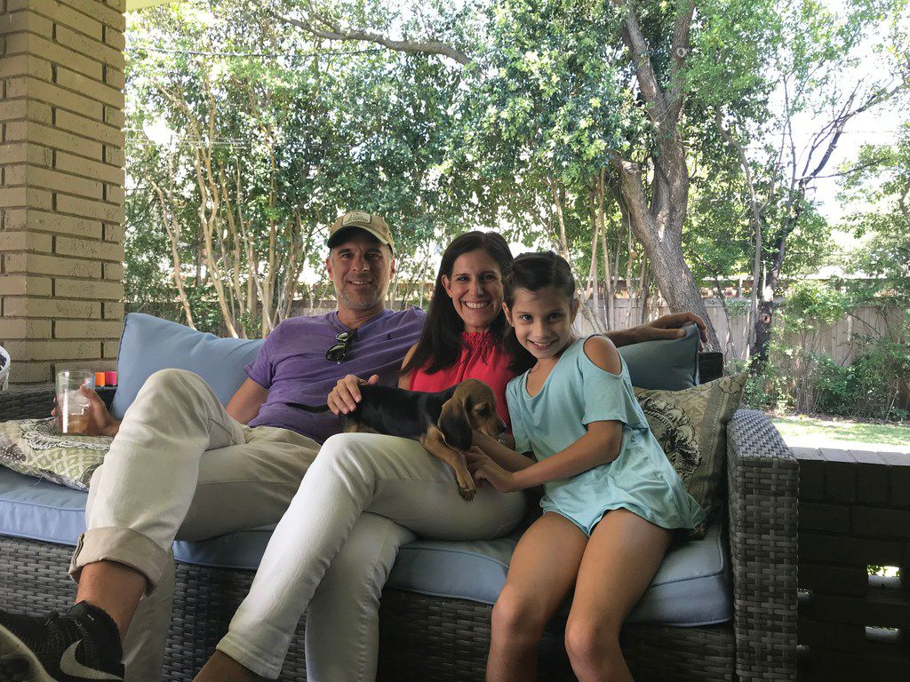 Canadian director Patrick Sisam, left, with Margaret Landis and daughter Kate, with puppy Bitsy, during filming of the Dallas segment of an upcoming Canadian documentary,  Vacations of the Brave,  that features Howdy Homemade Ice Cream.