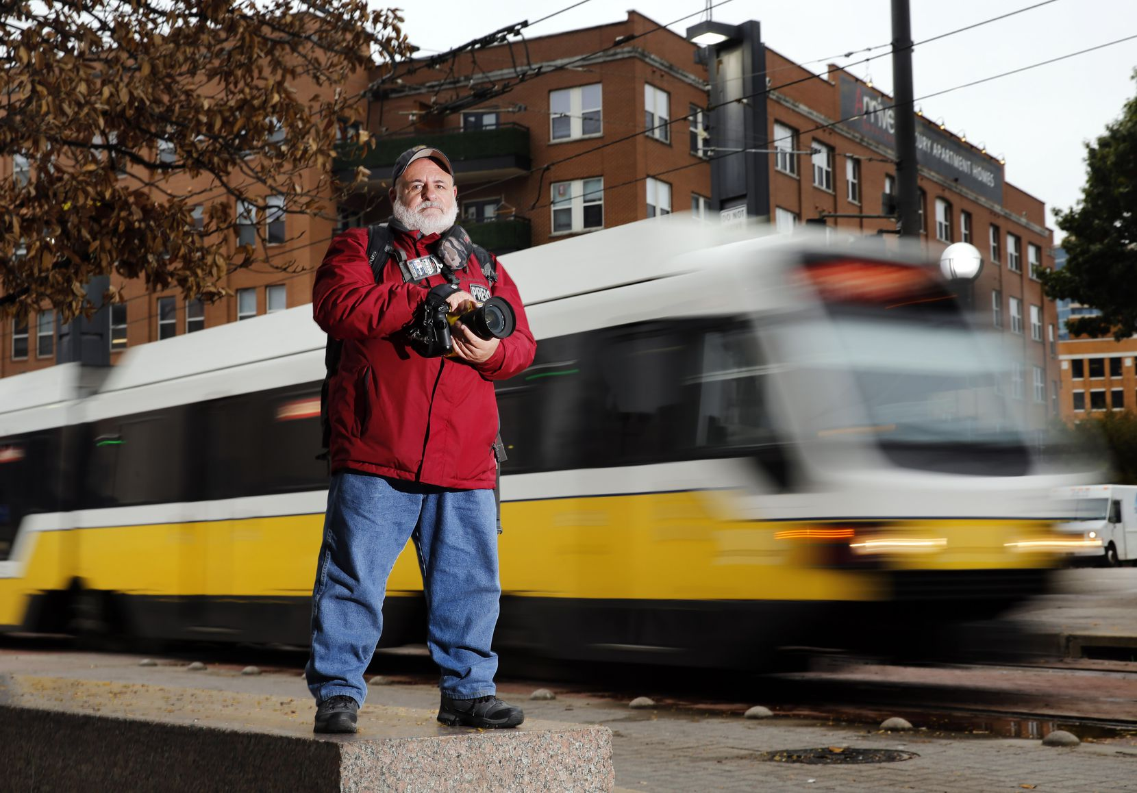 Dallas-Fort Worth's transit authority has agreed to pay Avi Adelman $345,000 to settle his federal civil rights lawsuit alleging he was illegally arrested for taking photos of someone being treated for an overdose on public property.