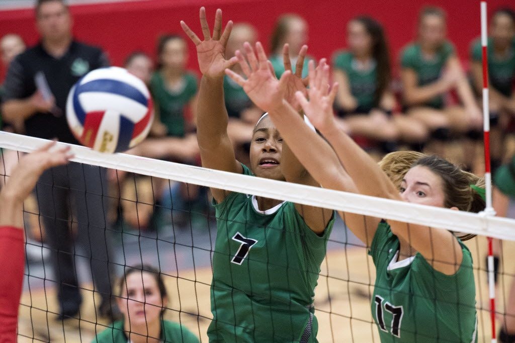 Southlake Carroll middle blocker Asjia O'Neal (7) and junior outside hitter Haley Hallgren go up for a block against Allen during their playoff volleyball game Friday, November 6, 2015 at Flower Mound Marcus High School in Flower Mound, Texas. (Jeffrey McWhorter/Special Contributor)