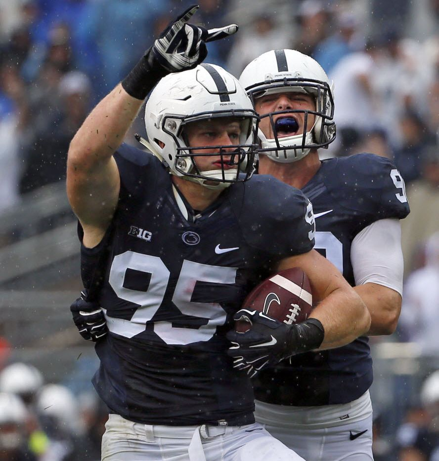 FILE - In this Saturday, Sept. 12, 2015, file photo, Penn State defensive end Carl Nassib (95) celebrates his second half interception with defensive end Garrett Sickels (90) during an NCAA college football game against Buffalo in State College, Pa. Nassib has been named to the AP All-America football team. (AP Photo/Gene J. Puskar, File)