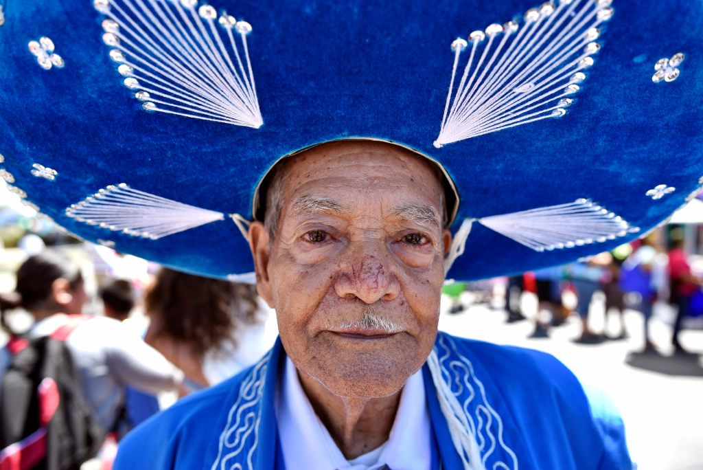 Juan Palacio, 86, originally of the Mexican state of Guanajuato, wears a mariachi outfit while walking along Jefferson Boulevard during the Dallas Cinco de Mayo festival celebrating it's 30th anniversary, Saturday, May 6, 2017 in Dallas. Ben Torres/Special Contributor