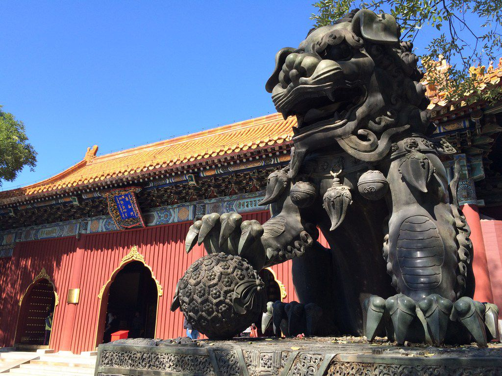 The statue of a dragon-like beast guards one of the buildings at Yonghe Temple in Beijing in September 2017.