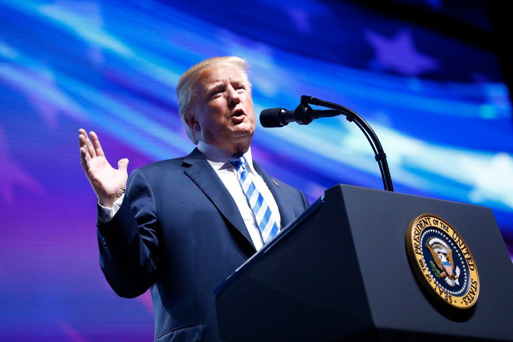 President Donald Trump speaks to the crowd assembled in the Kay Bailey Hutchison Convention Center for the NRA Annual Meeting in Dallas, Friday, May 4, 2018. . This is the second year as President that Trump has spoken to the gun rights group. (Tom Fox/The Dallas Morning News)