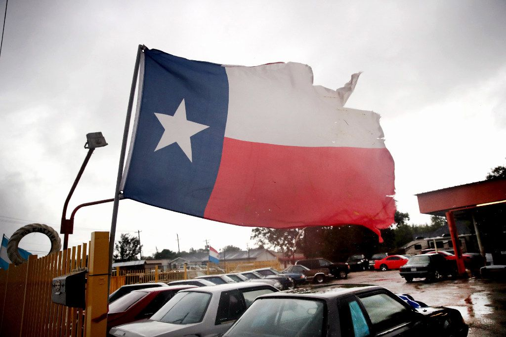 Wind from Hurricane Harvey batters a Texas flag on August 26, 2017 in Houston, Texas. Harvey, which made landfall north of Corpus Christi late last night, is expected to dump upwards to 40 inches of rain in Texas over the next couple of days.