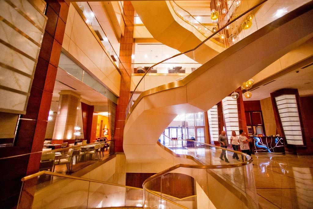 Patrons walk through the atrium at Renaissance Dallas Hotel.